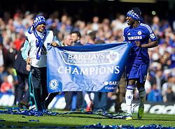 LONDON, ENGLAND - Sunday, May 3, 2015: Chelsea's Kurt Zouma celebrates winning the Premier League title after a 1-0 victory over Crystal Palace at Stamford Bridge. (Pic by David Rawcliffe/Propaganda)