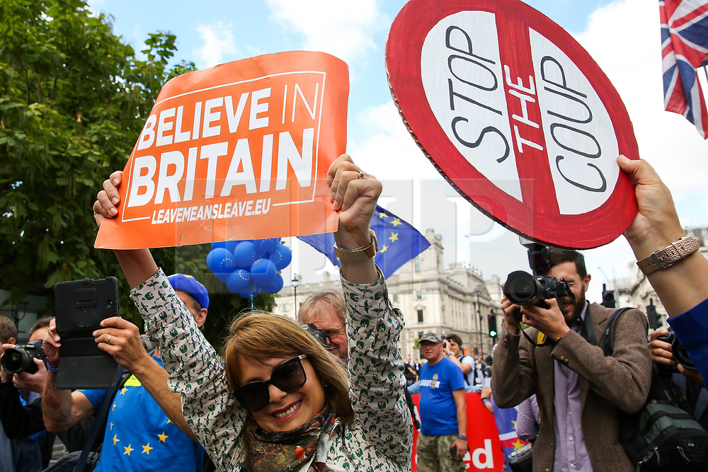 """© Licensed to London News Pictures. 03/009/2019. London, UK. A rival Pro-EU protester jumps as hundreds of anti-Brexit protesters take part in """"Stop The Coup"""" demonstration in Westminster. MPs return to Westminster for a no deal  showdown that could result in a snap election. Photo credit: Dinendra Haria/LNP"""