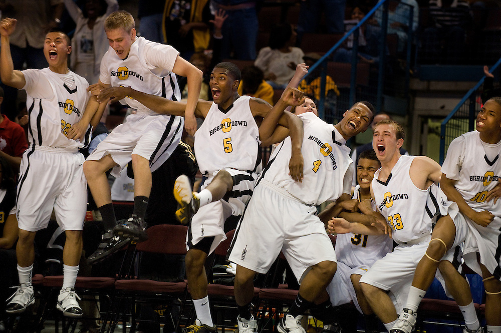 The Bishop O'Dowd team erupts with jubilation as they take the lead in the final seconds of the 2010 CIF State Basketball Championship game at Rabobank Arena in Bakersfield, CA.  March 27, 2010.
