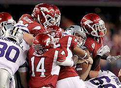 Kansas State quarterback Collin Klein (7) is swarmed by Arkansas defenders  during the 2012 AT&T Cotton Bowl game between Arkansas and Kansas State at Cowboy Stadium in Arlington, Tx. on Jan 6th, 2012.