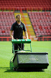 A groundsman cuts the new Ashton Gate pitch - Photo mandatory by-line: Dougie Allward/JMP - Mobile: 07966 386802 28/07/2014 - SPORT - FOOTBALL - Bristol - Ashton Gate - Wedlock Stand Demolition