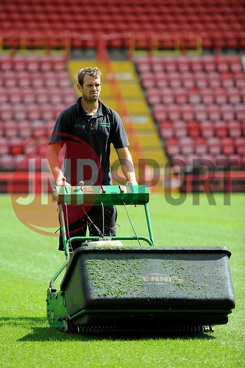A groundsman cuts the new Ashton Gate pitch - Photo mandatory by-line: Dougie Allward/JMP - Mobile: 07966 386802 28/07/2014 - SPORT - FOOTBALL - Bristol - Ashton Gate - Wedlock Stand Demolition
