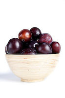 Studio shot of plums in bowl