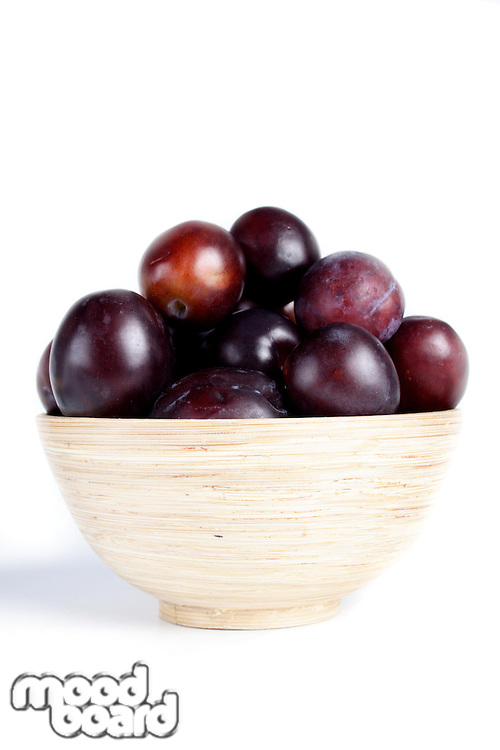 Studio shot of plums in bowl