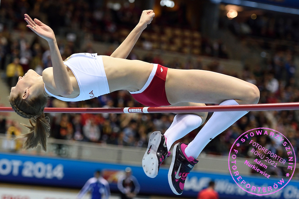 Kamila Licwinko (maiden name: Stepaniuk) of Poland competes in women's high jump final during the IAAF Athletics World Indoor Championships 2014 at Ergo Arena Hall in Sopot, Poland.<br /> Kamila Licwinko (maiden name: Stepaniuk) of Poland took gold medal and World Champion title.<br /> <br /> Poland, Sopot, March 8, 2014.<br /> <br /> Picture also available in RAW (NEF) or TIFF format on special request.<br /> <br /> For editorial use only. Any commercial or promotional use requires permission.<br /> <br /> Mandatory credit:<br /> Photo by &copy; Adam Nurkiewicz / Mediasport