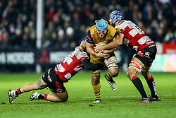 Jordan Crane (capt) of Bristol Rugby is tackled by Richard Hibbard and Mariano Galarza of Gloucester Rugby - Rogan Thomson/JMP - 03/12/2016 - RUGBY UNION - Kingsholm Stadium - Gloucester, England - Gloucester Rugby v Bristol Rugby - Aviva Premiership.