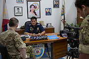 Image shows Major Dominic Bealey (left) and Second Lieutenant Ash Badwaj (right) from the Media Operations Group interviewing Police Senior Superintendent Jose Santiago Hidalgo Jr.<br /> <br /> Members of 77 Brigade on Exercise Civil Bridge 14A today visited the Philippine National Police offices &amp; The Rescue Emergency Disaster Training Facility, City of Pasig in Manila to discuss their earthquake contingency plans.<br /> 24/04/2015<br /> <br /> Credit should read: Cpl Mark Larner RY<br /> <br /> Exercise Civil Bridge is being conducted by elements of 77 Brigade &ndash; a specialist British military unit that is working alongside the government and disaster relief organisations as part of an annual overseas training exercise. <br /> <br /> Their mission during the two-week deployment will be to look at examples of the existing Philippine earthquake contingency response plans and, working with Philippine colleagues, make suggestions that will help save lives by enhancing the country&rsquo;s ability to respond to an earthquake in an urban setting.