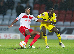 STEVENAGE, ENGLAND - Saturday, November 24, 2012: Tranmere Rovers' Zoumana Bakayogo in action against Stevenage's Lucas Akins during the Football League One match at Broadhall Way. (Pic by David Rawcliffe/Propaganda)