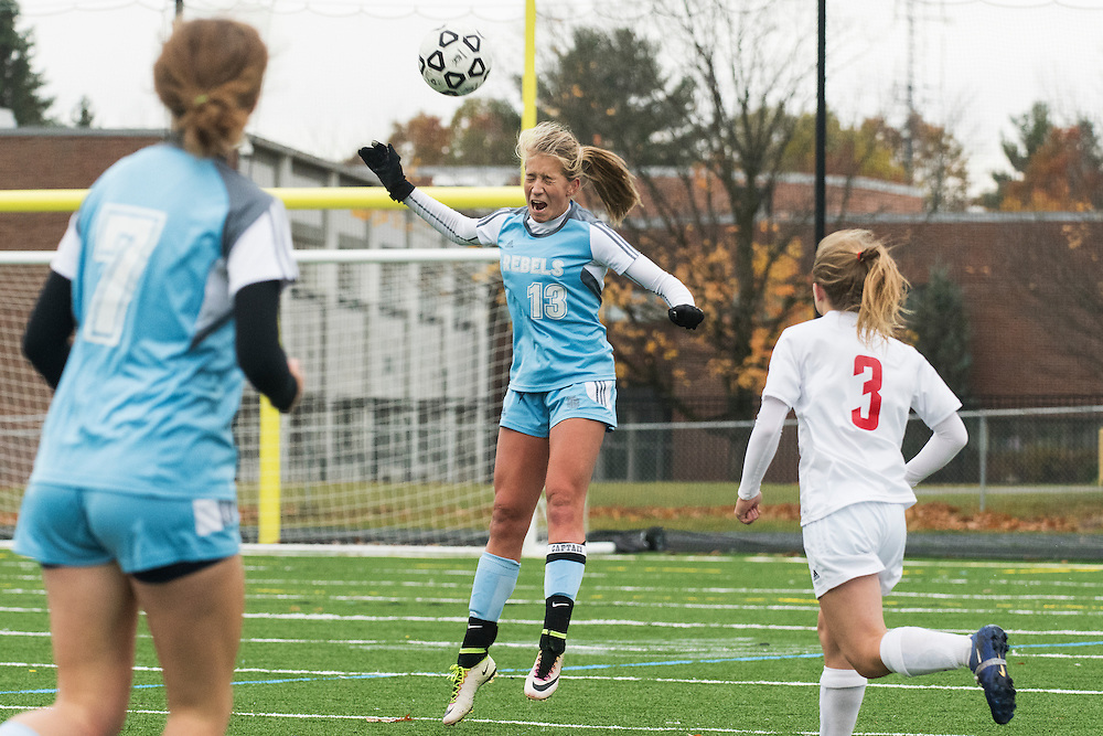 South Burlington's Annika Nielsen (13) leaps to head the ball during the girls high school playoff game between the Champlain Valley Union Redhawks and the South Burlington Rebels at South Burlington High School on Saturday afternoon October 29, 2016 in South Burlington. (BRIAN JENKINS/for the FREE PRESS)