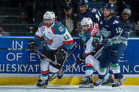 KELOWNA, CANADA - APRIL 30: Ryan Gropp #12 of the Seattle Thunderbirds checks Gordie Ballhorn #4 and Erik Gardiner #12 of the Kelowna Rockets on April 30, 2017 at Prospera Place in Kelowna, British Columbia, Canada.  (Photo by Marissa Baecker/Shoot the Breeze)  *** Local Caption ***