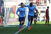 Football - 2017 / 2018 Premier League - AFC Bournemouth vs. Newcastle United<br /> <br /> Mohamed Diame of Newcastle United congratulates goalscorer Dwight Gayle of Newcastle United at Dean Court (Vitality Stadium) Bournemouth <br /> <br /> COLORSPORT/SHAUN BOGGUST