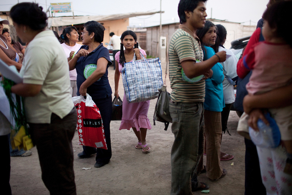 Residents of the Pachacutec neighborhood gather after a community workshop on Thursday, Apr. 16, 2009 in Ventanilla, Peru.