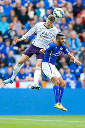 John Stones of Everton and Riyad Mahrez of Leicester City compete in the air - Photo mandatory by-line: Rogan Thomson/JMP - Mobile: 07966 386802 16/08/2014 - SPORT - FOOTBALL - Leicester - King Power Stadium - Leicester City v Everton - Barclays Premier League