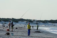 Surf fishers on the beach at dusk, Struisbaai, Western Cape, South Africa