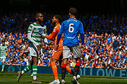 Odsonne Edouard of Celtic FC clashes with Connor Goldson  & Wesley Foderingham of Rangers FC during the Ladbrokes Scottish Premiership match between Rangers and Celtic at Ibrox, Glasgow, Scotland on 12 May 2019.
