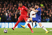 Bayern Munich defender Jerome Boateng passes the ball with Chelsea forward Olivier Giroud closing him down during the Champions League match between Chelsea and Bayern Munich at Stamford Bridge, London, England on 25 February 2020.