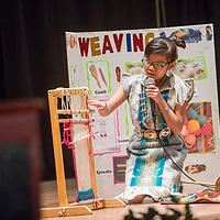 First-grade student Cheyenne Rae Baldwin describes the pieces of a loom in the traditional talent category during the 2018 Saint Michael Indian School Princess Pageant in St. Michael Thursday.