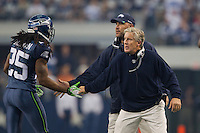 06 November 2011: Head coach Pete Carroll of the Seattle Seahawks congratulates his team after a fumble recovery while playing against the Dallas Cowboys during the first half of the Cowboys 23-13 victory over the Seahawks at Cowboy Stadium in Arlington, TX.