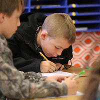 Ethan LaMontagne works to solve his teams math problem at Wednesday's math/science boot camp.