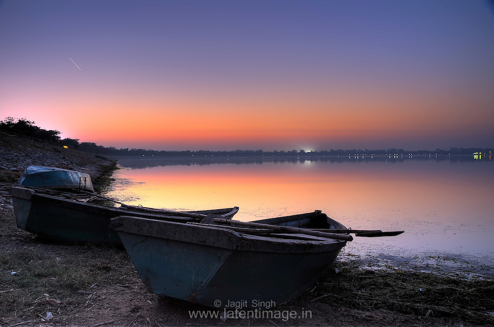 Witnessing the sunset with the boats at Sukhna Lake, Chandigarh.