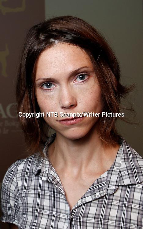Oslo  20111101. Forfatter Mette Karlsvik ble tirsdag nominert til Brageprisen 2011.<br /> Foto: Erlend Aas / Scanpix<br /> <br /> NTB Scanpix/Writer Pictures<br /> <br /> WORLD RIGHTS, DIRECT SALES ONLY, NO AGENCY