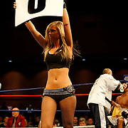 Ring girls doing their thing during the bouts at the Meidenbauer Center in Bellevue, WA on December 13, 2008.