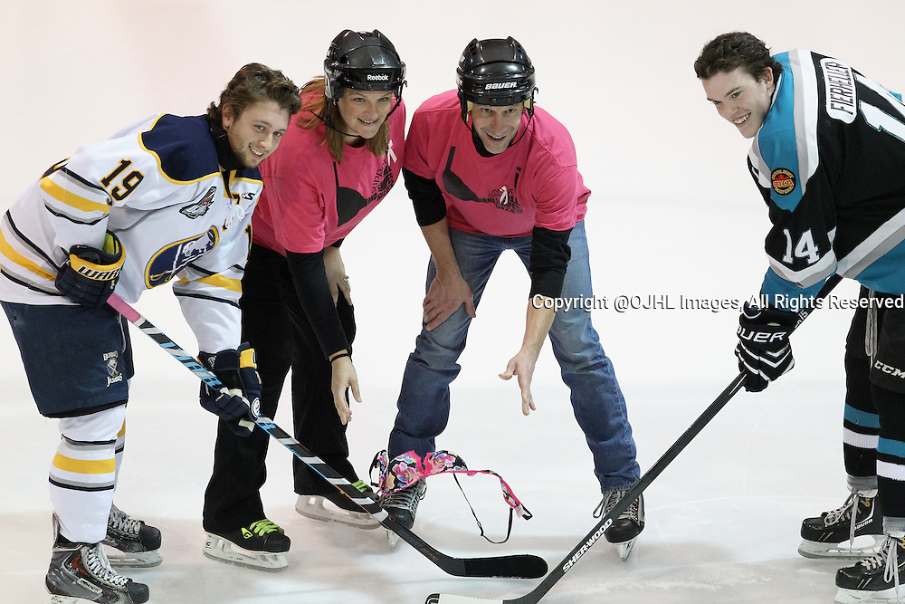 LINDSAY, ON - Oct 16, 2015 : Ontario Junior Hockey League game action between Buffalo and Lindsay. Bob FM Radio personalities and Buffalo and Lindsay Team Captains at the pregame &quot;BRA&quot; drop ceremony as part of the Lindsay Muskies breast cancer awareness campaign.<br /> (Photo by Tim Bates / OJHL Images)