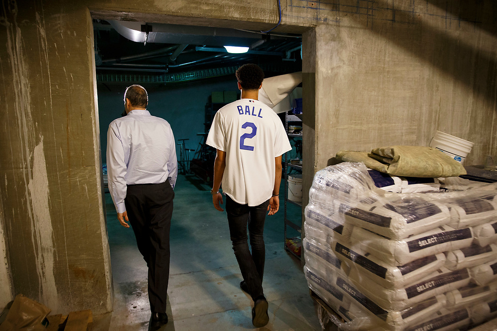 Lon Rosen, executive vice president and chief marketing officer for the Los Angeles Dodgers, guides Lakers draft pick Lonzo Ball through a tunnel before throwing out the first pitch at Dodger Stadium on Friday, June 23, 2017 in El Segundo, California. The Lakers selected Lonzo Ball as the No. 2 overall NBA draft pick and is the son of LaVar Ball. © 2017 Patrick T. Fallon