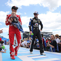 Race car drivers Kyle Larson (L) and Kasey Kahne are seen during driver introductions prior to the 58th Annual NASCAR Daytona 500 auto race at Daytona International Speedway on Sunday, February 21, 2016 in Daytona Beach, Florida.  (Alex Menendez via AP)