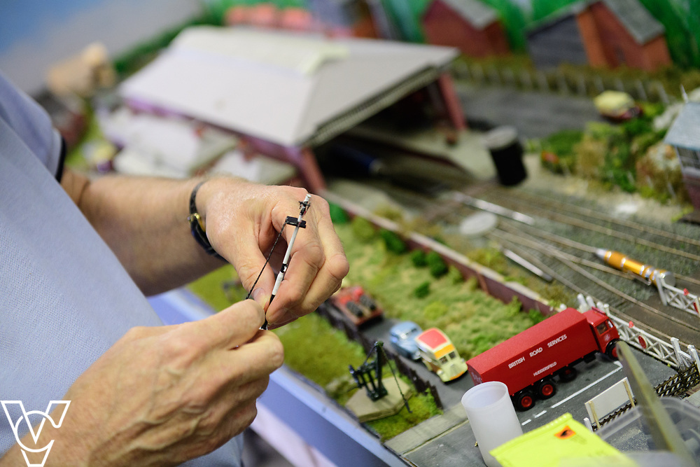 INSIGHT MAGAZINE: Bridlington Model Railway Society are based in Station Road, Bridlington, in a railway arch unit owned by Network Rail.  Pictured is Neil Porter working on the model of Filey Station.<br /> <br /> Picture: Chris Vaughan Photography<br /> Date: May 31, 2017