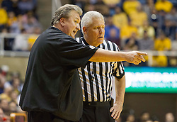 West Virginia Mountaineers head coach Bob Huggins talks to a referee against the Texas Longhorns during the second half at the WVU Coliseum.