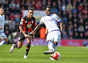 Bournemouth Midfielder Junior Stanislas (19) and Chelsea Defender Baba Rahman (6) during the Barclays Premier League match between Bournemouth and Chelsea at the Goldsands Stadium, Bournemouth, England on 23 April 2016. Photo by Adam Rivers.