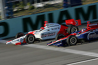 Roger Yasukawa and Helio Castroneves race at the Homestead-Miami Speedway, Toyota Indy 300, March 6, 2005