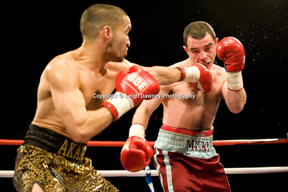 Akaash Bhatia (gold shorts) defeats Mickey Coveney at Brentwood Centre 22nd January 2010, Frank Maloney Promotions,Credit: © Leigh Dawney Photography