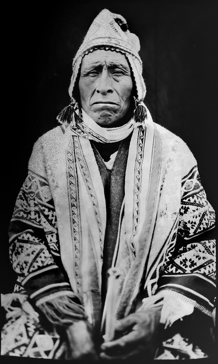 In this June 12, 2017 photo taken with a 19th century style box camera, Bernardino Quispe Saca, 58, poses for a portrait in the Sinakara Valley, during the Qoyllur Rit'i festival. The gathering is held every year shortly before the Christian feast of Corpus Christi and draws as many as 100,000 people to the Quispicanchis province in Peru's Cuzco region.