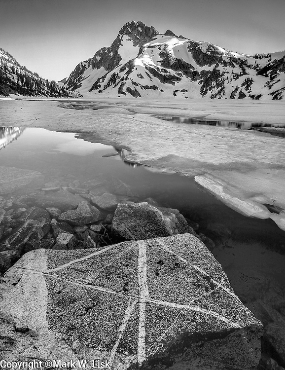 Melting ice reveals the clear water of Sawtooth Lake the largest lake in the Sawtooth Wilderness.