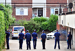 &copy; Licensed to London News Pictures. 08/08/2018<br /> Deptford, UK. Police search team searching garage area opposite a property where 7 year Joel Urhie was killed in a suspicious house fire at Adolphus Street, Deptford.  <br /> Photo credit: Grant Falvey/LNP