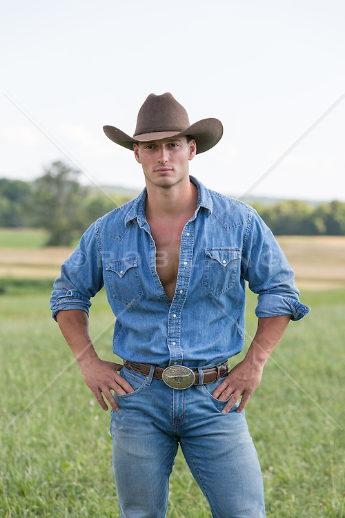 cowboy standing alone on a ranch