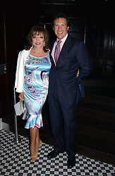 Actress JOAN COLLINS and her husband PERCY GIBSON at a party hosted by Frankie Dettori, Marco Pierre White and Edward Taylor to celebrate the launch of Frankie's Italian Bar & Grill at 3 Yeomans Row, London SW3 on 2nd September 2004.