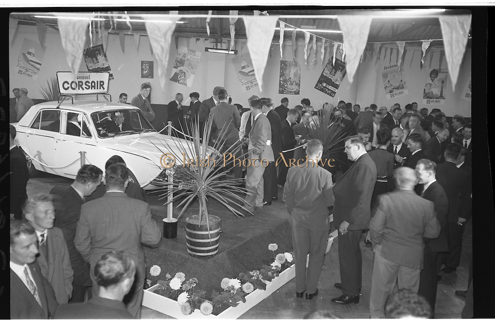 "Launch Of New Ford Corsair..1963..01.10.1963..10.01.1963..1st October 1963..Today saw the launch of a new car to the market. At the Smithfield Motor Company in Drumcondra, Ford launched ""The Corsair"".,The Corsair was one of the four model Consul range, and shared many of its mechanical components with the Cortina, Classic and Capri. The Corsair had unusual and quite bold styling for its day, with a sharp horizontal V-shaped crease at the very front of the car into which round headlights were inset...Picture shows the level of interest generated by the launch of the new ""Corsair' by Ford."