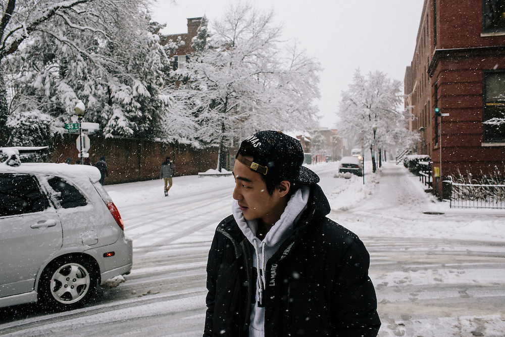 Roy Kim, a Georgetown University sophomore, walks to the library during a snow storm to continue working on recording an English language track for his recording class. Kim became a South Korean pop star after winning Superstar K4, his country's version of American Idol. Kim is hoping he can release a new album by September while maintaining good grades in college.