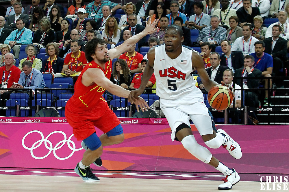 12 August 2012: USA Kevin Durant drives past Sergio Llull during 107-100 Team USA victory over Team Spain, during the men's Gold Medal Game, at the North Greenwich Arena, in London, Great Britain.