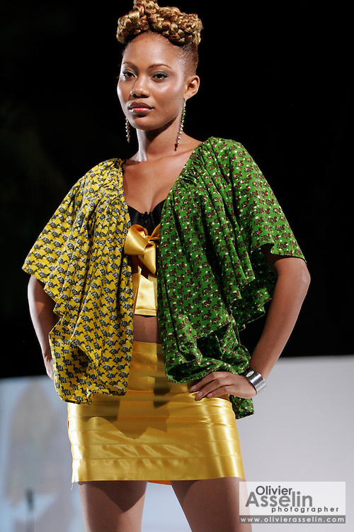 Models wearing outfits from the Tina Atiemo Collection walk down the catwalk during the Catwalk the World fund raising fashion show at the Golden Tulip hotel in Ghana's capital Accra on Friday Dec. 22, 2006. The show features the work of top African designers and is part of a world-touring fundraiser organized by the United Nations' World Food Programme and Health PR to help fight hunger worldwide.