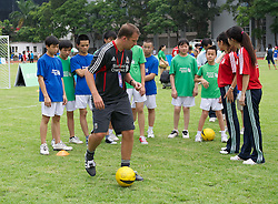 GUANGZHOU, CHINA - Wednesday, July 13, 2011: A Liverpool coach during a coaching clinic for local youngsters at the Guangzhou Sports University during day three of the club's Asia Tour. (Photo by David Rawcliffe/Propaganda)