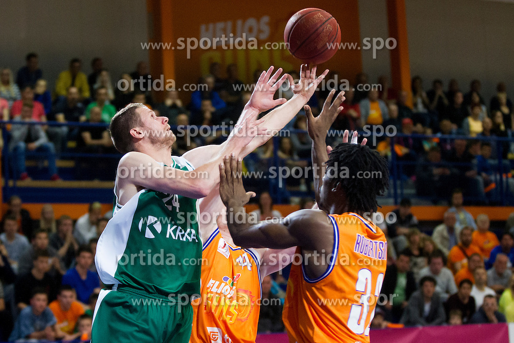 Luka Lapornik of KK Krka and Hugh Robertson of KK Helios Suns during basketball match between KK Helios Suns and KK Krka in semi-final of Nova KBM Champions League 2015/16, on May 23, 2016 in Hala Kominalnega Centra, Domzale, Slovenia. Photo by Urban Urbanc / Sportida