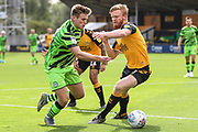 Forest Green Rovers Kyle Taylor(28),on loan from Bournemouth takes on Cambridge United's Liam O'Neil(8) during the EFL Sky Bet League 2 match between Cambridge United and Forest Green Rovers at the Cambs Glass Stadium, Cambridge, England on 7 September 2019.