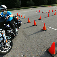 Tupelo Police Officer Patrick Johnson starts off his the mornig of July 31 with a quick warm up lap through the training course.