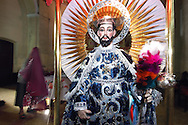 Bolivia. Tarija. San Roque..In Tarija the saint always wears very elegant clothes, provided by the faithful, every time the saint comes out wearing a different outfit, doña Wilma and Don Marcelo to ensure complete change before each pocessione.