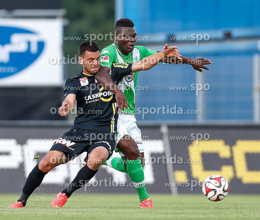 23.07.2014, Cashpoint Arena, Altach, Testspiel, SCR Altach vs VfL Wolfsburg, im Bild Zweikampf zwischen Darijo Pecirep, (SCR Altach, #09) und Junior Malanda, (Vfl Wolfsburg, #19)// during the friendly Match between SCR Altach vs VfL Wolfsburg at the Cashpoint Arena, Altach Austria on 2014/07/23. EXPA Pictures © 2014, PhotoCredit: EXPA/ Peter Rinderer