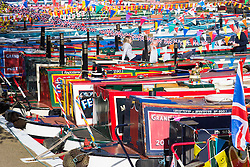 Little Venice, London, May 1 2016. Bright sunshine greets narrow boaters at the Inland Waterways Association's annual Canalway Cavalcade, a get-together of narrow boaters from all over the UK, on the May Day bank holiday. PICTURED: Bunting, polished brasswork and brightly painted boats create a riot of colour. ©Paul Davey<br /> FOR LICENCING CONTACT: Paul Davey +44 (0) 7966 016 296 paul@pauldaveycreative.co.uk